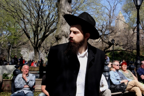 A young orthodox Jewish man enjoying a stroll.