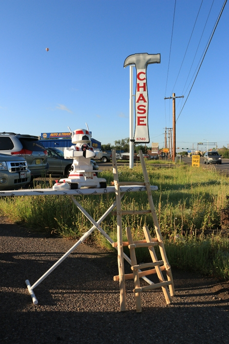 Albuquerque | Garage Sale Quirky Mashup | Ironing Board, Robot, Decorative Ladders, and a hot air balloon at 11 O'Clock in the distant sky.
