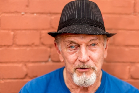 Stranger Portrait 65 of 100 is of TEX, an 80 year old man with a black fedora and goatee