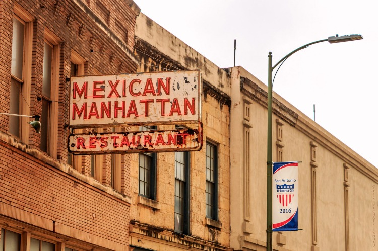 A neon sign with cultural contrasts