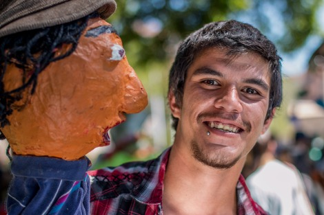 A young man and a papier mache puppet